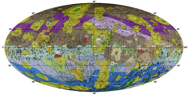 Mappa geologica dell'asteroide gigante Vesta. I toni di marrone rappresentano la superficie più antica. I toni di viola nel nord e di azzurro rappresentano terreni modificati dagli impatti Veneneia e Rheasilvia rispettivamente. I toni di viola chiari e blu scuri sotto l'equatore rappresentano l'interno dei bacini Rheasilvia e Veneneia. I verdi e gialli rappresentano relativamente giovani frane o altri materiali in movimento in discesa e di impatto in crateri (Immagine NASA/JPL-Caltech/ASU)
